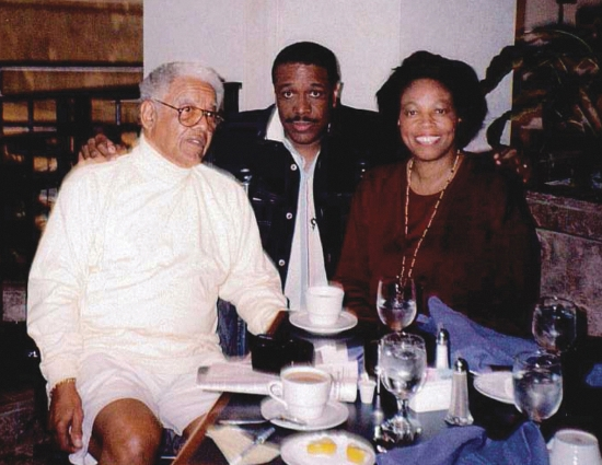 At the Rollins Colloquium, 1996: from left, Charlemae Hill Rollins's son, Joseph Rollins Jr.; author Christopher Paul Curtis; and Dr. Bracy. Photo courtesy of Pauletta Brown Bracy.